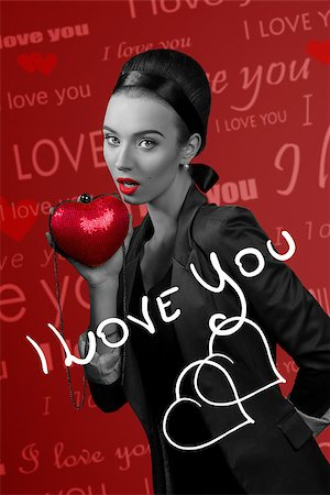 lovely brunette with small heart shaped bag in the hand, remeber valentines day , images part in black and white with hand made written Stock Photo - Budget Royalty-Free & Subscription, Code: 400-08378604