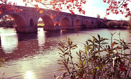 puentes - a view of the Puente Romano, an ancient Roman bridge over the Guadiana River, in Merida, Spain, with a filter effect Stock Photo - Budget Royalty-Free & Subscription, Code: 400-08378973
