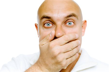 pzromashka (artist) - Bald blue eyes frightened man in a white jacket covers her mouth with his hand. Studio. isolated Stock Photo - Budget Royalty-Free & Subscription, Code: 400-08372188