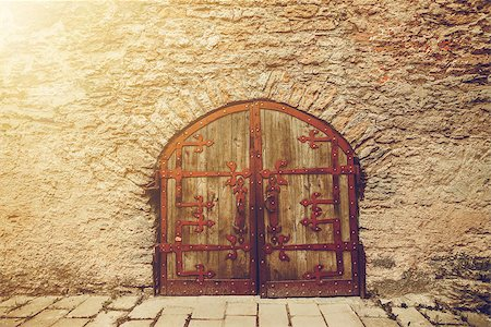 old Wooden door with ornaments Stock Photo - Budget Royalty-Free & Subscription, Code: 400-08372423