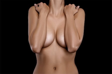 naked young woman covering her breast with hands against black background Stock Photo - Budget Royalty-Free & Subscription, Code: 400-08406162