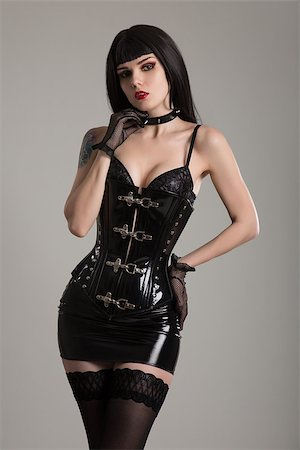 Dominatrix woman in black fetish corset, mini skirt, and stockings Stock Photo - Budget Royalty-Free & Subscription, Code: 400-08430521