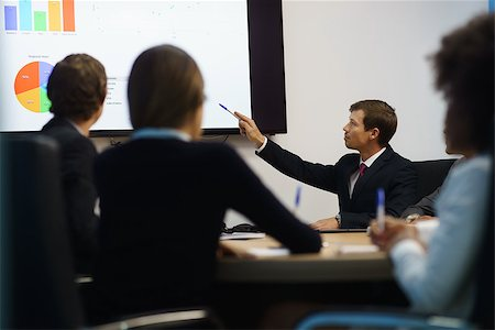 diego_cervo (artist) - Group of business people meeting in corporate conference room, smiling during a presentation. The coworkers are examining charts and slides on a big TV monitor Stock Photo - Budget Royalty-Free & Subscription, Code: 400-08433253