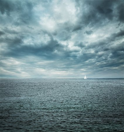 sailing boat storm - Sailing Boat at Stormy Sea. Dark Background. Loneliness Concept. Toned Photo. Copy Space. Stock Photo - Budget Royalty-Free & Subscription, Code: 400-08496864