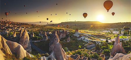 Hot air balloon flying over spectacular Cappadocia Stock Photo - Budget Royalty-Free & Subscription, Code: 400-08500425