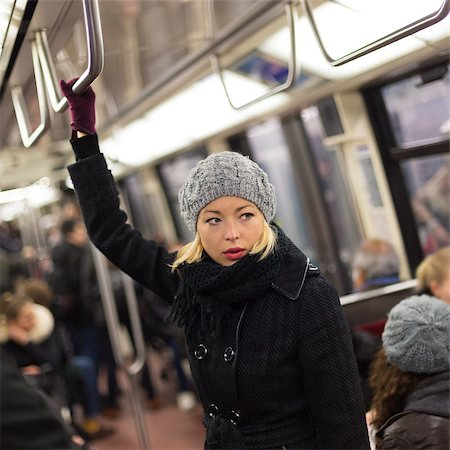 Beautiful blonde caucasian lady wearing winter coat traveling by metro in rush hour. Public transport. Stock Photo - Budget Royalty-Free & Subscription, Code: 400-08532579
