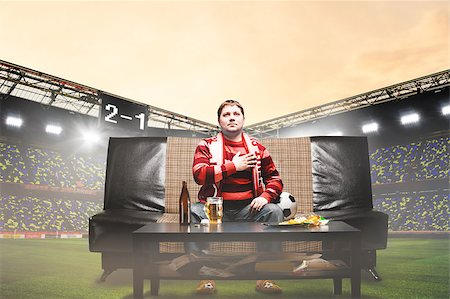 fat man balls - happy soccer or football fan with hand on heart on sofa at stadium Stock Photo - Budget Royalty-Free & Subscription, Code: 400-08669614