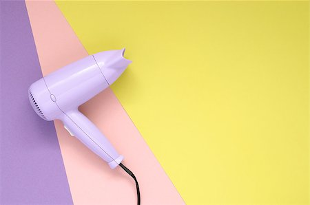 paper blower - Purple hair dryer on purpe, pink and yellow paper background Stock Photo - Budget Royalty-Free & Subscription, Code: 400-08676435