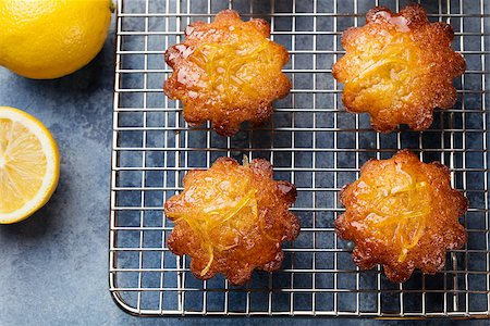 Lemon muffins cakes, financiers on a cooling rack Blue stone background Top view Stock Photo - Budget Royalty-Free & Subscription, Code: 400-08670409