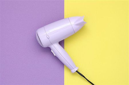 paper blower - Purple hair dryer on purple and yellow paper background Stock Photo - Budget Royalty-Free & Subscription, Code: 400-08673953