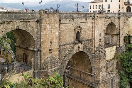 puentes - The Puente Nuevo (New Bridge) is largest bridges that span the 120-metre deep chasm that divides the city of Ronda, Spain. In was build in 1793 Stock Photo - Budget Royalty-Free & Subscription, Code: 400-08694755