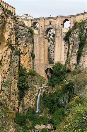 puentes - The Puente Nuevo (New Bridge) is largest bridges that span the 120-metre deep chasm that divides the city of Ronda, Spain. In was build in 1793 Stock Photo - Budget Royalty-Free & Subscription, Code: 400-08695646