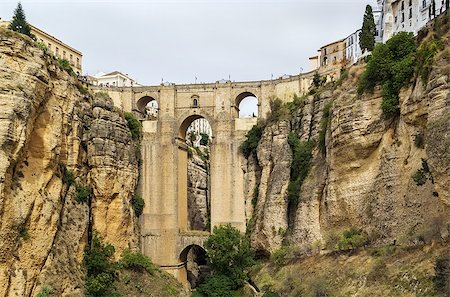 puentes - The Puente Nuevo (New Bridge) is largest bridges that span the 120-metre deep chasm that divides the city of Ronda, Spain. In was build in 1793 Stock Photo - Budget Royalty-Free & Subscription, Code: 400-08695648