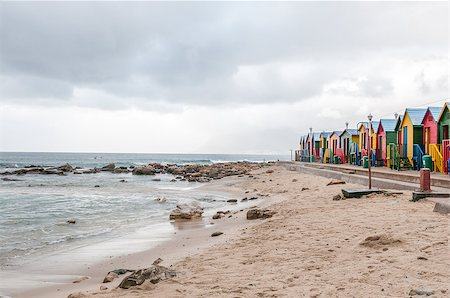 Multi-coloured beach huts at St. James beach on a rainy morning Stock Photo - Budget Royalty-Free & Subscription, Code: 400-08708571