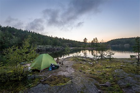 Late evening landscape view of Ladoga lake islands and small tourist tent on the rocks. Karelia, Russia. Stock Photo - Budget Royalty-Free & Subscription, Code: 400-08736119