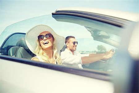 road trip, travel, dating, couple and people concept - happy man and woman driving in cabriolet car outdoors Stock Photo - Budget Royalty-Free & Subscription, Code: 400-08757872