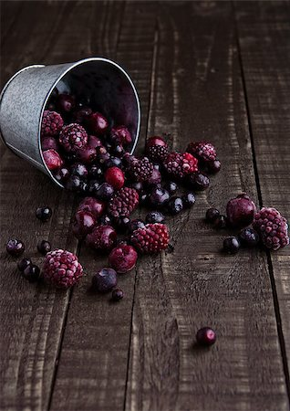 Frozen berries mix in a black bowl on wooden background. Still life photography Stock Photo - Budget Royalty-Free & Subscription, Code: 400-08759192