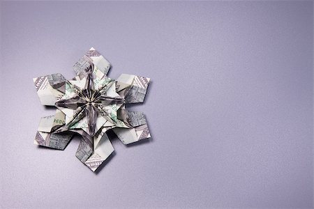 simsearch:400-05936191,k - snowflake origami made of banknotes dollar Handmade Stock Photo - Budget Royalty-Free & Subscription, Code: 400-08774298