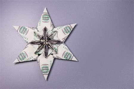 simsearch:400-05936191,k - snowflake origami made of banknotes dollar Handmade Stock Photo - Budget Royalty-Free & Subscription, Code: 400-08774300