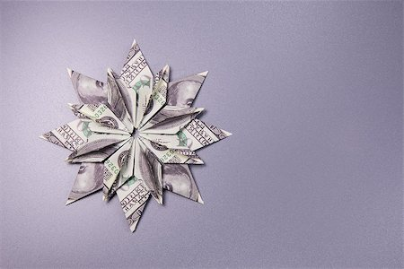 simsearch:400-05936191,k - snowflake origami made of banknotes dollar Handmade Stock Photo - Budget Royalty-Free & Subscription, Code: 400-08774301