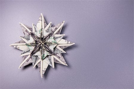 simsearch:400-05936191,k - snowflake origami made of banknotes dollar Handmade Stock Photo - Budget Royalty-Free & Subscription, Code: 400-08774303