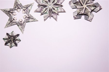 simsearch:400-05936191,k - snowflake origami made of banknotes dollar Handmade Stock Photo - Budget Royalty-Free & Subscription, Code: 400-08774346