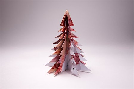 simsearch:400-05936191,k - Christmas tree origami made of banknotes rubles. Handmade Stock Photo - Budget Royalty-Free & Subscription, Code: 400-08777047