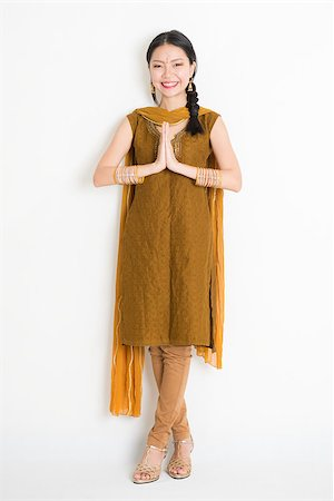 punjabi - Portrait of mixed race Indian Chinese woman in traditional punjabi dress greeting, full length standing on plain white background. Stock Photo - Budget Royalty-Free & Subscription, Code: 400-08785744