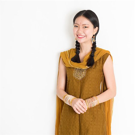 punjabi - Portrait of attractive mixed race Indian Chinese woman in traditional Punjabi dress smiling, standing on plain white background. Stock Photo - Budget Royalty-Free & Subscription, Code: 400-08787347