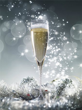 silver box - One champagne glass and silver decoration on a silver shiny glitter background Stock Photo - Budget Royalty-Free & Subscription, Code: 400-08795839