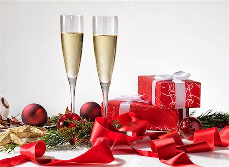 silver box - Two champagne glasses, christmas decoration and two red gifts with white ribbon Stock Photo - Budget Royalty-Free & Subscription, Code: 400-08795840