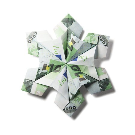 simsearch:400-05936191,k - snowflake origami made of banknotes on a white background. Handmade Stock Photo - Budget Royalty-Free & Subscription, Code: 400-08808425