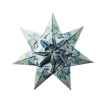 simsearch:400-05936191,k - snowflake origami made of banknotes on a white background. Handmade Stock Photo - Budget Royalty-Free & Subscription, Code: 400-08808426
