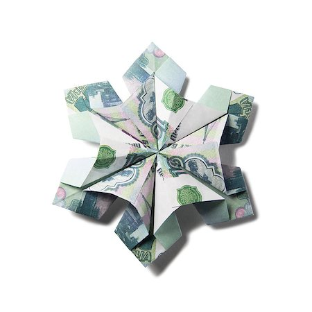 simsearch:400-05936191,k - snowflake origami made of banknotes on a white background. Handmade Stock Photo - Budget Royalty-Free & Subscription, Code: 400-08808427
