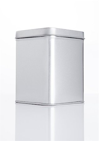 silver box - Emty tea steel container jar on white background with reflection Stock Photo - Budget Royalty-Free & Subscription, Code: 400-08809579