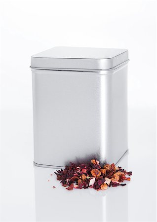 silver box - Fruit tea steel jar with loose tea next to it on white background Stock Photo - Budget Royalty-Free & Subscription, Code: 400-08809581