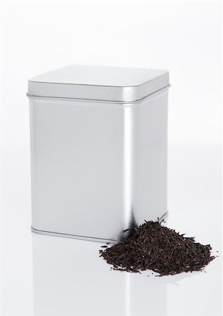 silver box - Black tea steel jar with loose tea next to it on white background Stock Photo - Budget Royalty-Free & Subscription, Code: 400-08809582