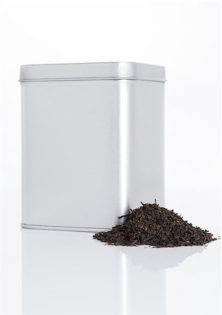 silver box - Black tea steel jar with loose tea next to it on white background Stock Photo - Budget Royalty-Free & Subscription, Code: 400-08809583