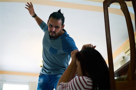 diego_cervo (artist) - Social issues, abuse and aggression on women, young drunk man hitting and beating woman at home after drinking alcohol. Violent husband fighting with abused wife Stock Photo - Budget Royalty-Free & Subscription, Code: 400-08815869