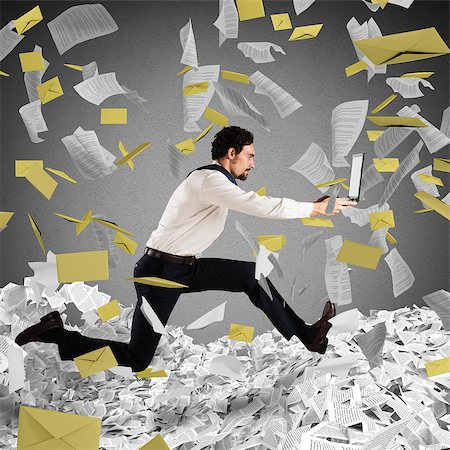 running away scared - Businessman with laptop runs away from a paperwork and bureaucracy Stock Photo - Budget Royalty-Free & Subscription, Code: 400-08810148