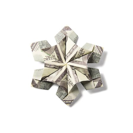 simsearch:400-05936191,k - snowflake origami made of banknotes on a white background. Handmade Stock Photo - Budget Royalty-Free & Subscription, Code: 400-08811368