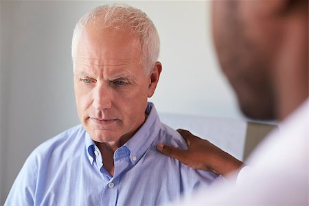 Doctor Talking To Unhappy Male Patient In Exam Room Stock Photo - Budget Royalty-Free & Subscription, Code: 400-08839485