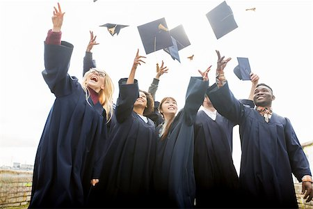 education, graduation and people concept - group of happy international students in bachelor gowns throwing mortar boards up Stock Photo - Budget Royalty-Free & Subscription, Code: 400-08832930