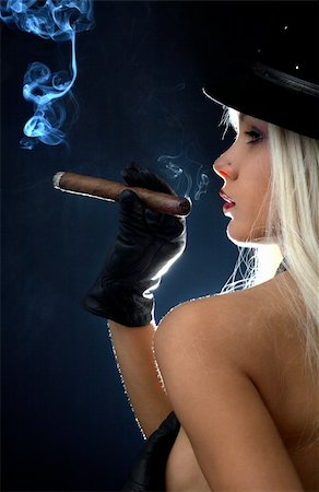 backlight image of topless girl smoking cigar Stock Photo - Budget Royalty-Free & Subscription, Code: 400-03914321