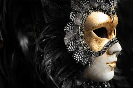 Venetian mask decorated with gold leaf and embedded with fowl feathers. Stock Photo - Budget Royalty-Free & Subscription, Code: 400-03914393