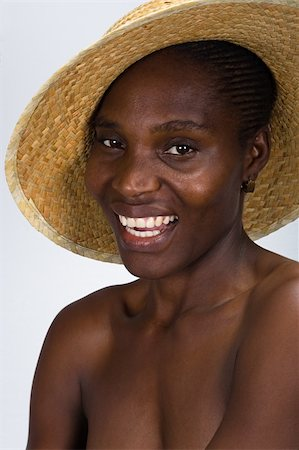 afro hairstyle, young beautiful African American girl with hat, people diversity series Stock Photo - Budget Royalty-Free & Subscription, Code: 400-03914685