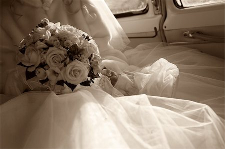The bride with a bouquet in the retro automobile. Style retro Stock Photo - Budget Royalty-Free & Subscription, Code: 400-03911907