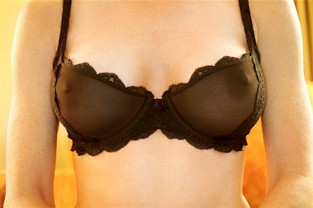 Close up of Caucasian woman wearing sheer black bra. Stock Photo - Budget Royalty-Free & Subscription, Code: 400-03924837