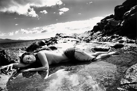 Nude Caucasian mid adult woman lying in tidal pool at Maui coast with eyes closed and head on arm. Stock Photo - Budget Royalty-Free & Subscription, Code: 400-03925143