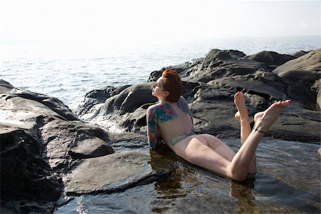 Sexy nude tattooed Caucasian woman lying in tidal pool in Maui, Hawaii, USA. Stock Photo - Budget Royalty-Free & Subscription, Code: 400-03925197